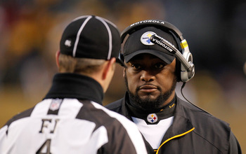 PITTSBURGH, PA - JANUARY 15:  Head coach Mike Tomlin of the Pittsburgh Steelers speaks with a referee during the AFC Divisional Playoff Game against the Baltimore Ravens at Heinz Field on January 15, 2011 in Pittsburgh, Pennsylvania.  (Photo by Gregory Sh