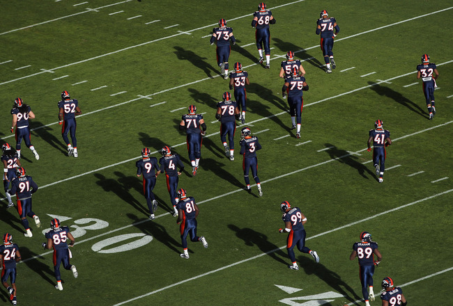 DENVER - DECEMBER 26:  The Denver Broncos take the field to warm up prior to facing the Houston Texas at INVESCO Field at Mile High on December 26, 2010 in Denver, Colorado. The Broncos defeated the Texans 24-23.  (Photo by Doug Pensinger/Getty Images)