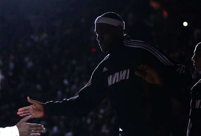 MIAMI, FL - JANUARY 22:  LeBron James #6 of the Miami Heat greets teammates during a game against the Toronto Raptors at American Airlines Arena on January 22, 2011 in Miami, Florida. NOTE TO USER: User expressly acknowledges and agrees that, by downloadi