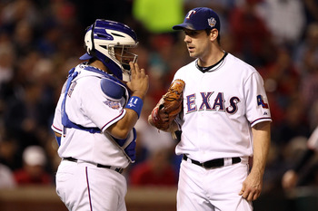 ARLINGTON, TX - NOVEMBER 01:  (L-R) Bengie Molina #11 and Cliff Lee #33 of the Texas Rangers talk on the mound against the San Francisco Giants in Game Five of the 2010 MLB World Series at Rangers Ballpark in Arlington on November 1, 2010 in Arlington, Te