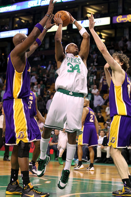 BOSTON - JUNE 08:  Paul Pierce #34 of the Boston Celtics goes up for a shot over Lamar Odom #7 and Pau Gasol #16 of the Los Angeles Lakers in Game Three of the 2010 NBA Finals on June 8, 2010 at TD Garden in Boston, Massachusetts. NOTE TO USER: User expre