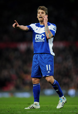 MANCHESTER, ENGLAND - JANUARY 22:  David Bentley of Birmingham City gestures during the Barclays Premier League match between Manchester United and Birmingham City at Old Trafford on January 22, 2011 in Manchester, England. (Photo by Shaun Botterill/Getty