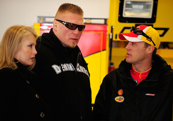 DAYTONA BEACH, FL - FEBRUARY 13:  MMA fighter Brock Lesnar(C)  speaks with Kevin Harvick(R), driver of the #29 Shell/Pennzoil Chevrolet, during practice for the Daytona 500 at Daytona International Speedway on February 13, 2010 in Daytona Beach, Florida.