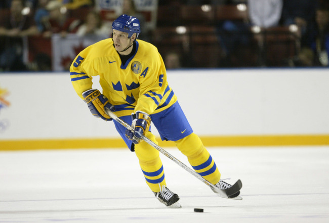 15 Feb 2002:    As he skates down the ice, Nicklas Lidstrom #5 of Sweden looks to pass the puck during the Salt Lake City Winter Olympic Games at the E Center in Salt Lake City, Utah. DIGITAL IMAGE. Mandatory Credit:   Brian Bahr/Getty Images