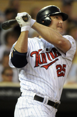 MINNEAPOLIS, MN - MAY 27: Jim Thome #25 of the Minnesota Twins hits a scarifice fly to score Orlando Hudson #1 in the fifth inning against the New York Yankees during their game on May 27, 2010 at Target Field in Minneapolis, Minnesota. The Twins defeated
