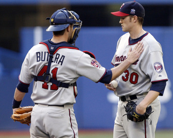 TORONTO - JULY 8: Drew Butera #41 comforts Scott Baker #30 of the Minnesota Twins after an Adam Lind home run during a MLB game against the Toronto Blue Jays at The Rogers Centre July 8, 2010 in Toronto, Ontario, Canada. (Photo by Abelimages/Getty Images)