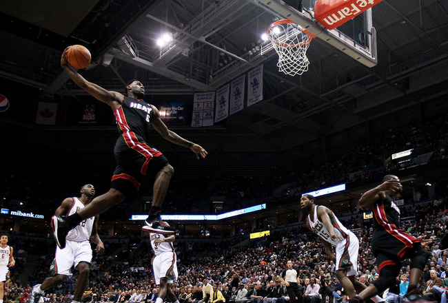 MILWAUKEE, WI - DECEMBER 06: LeBron James #6 of the Miami Heat goes up for a dunk against the Milwaukee Bucks at the Bradley Center on December 6, 2010 in Milwaukee, Wisconsin. NOTE TO USER: User expressly acknowledges and agrees that, by downloading and/