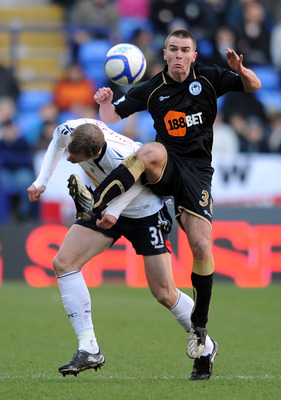 BOLTON, ENGLAND - JANUARY 29: David Wheater of Bolton Wanderers competes with Callum McManaman of Wigan Athletic during the FA Cup sponsored by E.ON 4th Round match between Bolton Wanderers and Wigan Athletic on January 29, 2011 in Bolton, England.  (Phot