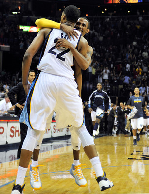 Mike Conley and Rudy Gay celebrate a hard fought victory