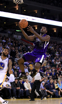 OAKLAND, CA - JANUARY 21:  Tyreke Evans #13 of the Sacramento Kings goes up for a shot against the Golden State Warriors at Oracle Arena on January 21, 2011 in Oakland, California. NOTE TO USER: User expressly acknowledges and agrees that, by downloading