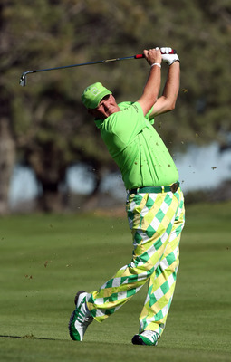 LA JOLLA, CA - JANUARY 28: John Daly hits of the 14th fairway during the second round of the Farmers Insurance Open at Torrey Pines on January 28, 2011 in La Jolla, California. (Photo by Donald Miralle/Getty Images)