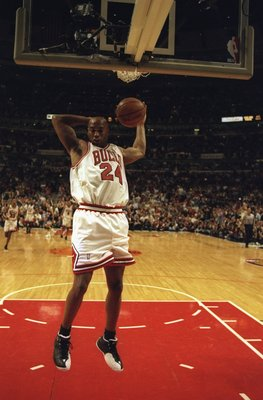 7 Jun 1998:  Scott Burrell #24 of the Chicago Bulls makes a dunk on a fast break during the NBA Finals game 3 against the Utah Jazz at the United Center in Chicago, Illinois.  The Bulls defeated the Jazz 96-54. Mandatory Credit: Jonathan Daniel  /Allsport