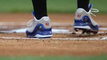 ARLINGTON, TX - APRIL 15:  The shoes of Adam Jones of the Baltimore Orioles with the #42 to commemorate Jackie Robinson day during a game against the Texas Rangers on April 15, 2009 at Rangers Ballpark in Arlington, Texas.  (Photo by Ronald Martinez/Getty