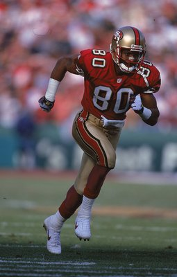 12 Dec 1999:  Jerry Rice #80 of the San Francisco 49ers runs on the field during the game against the Atlanta Falcons at 3Comm Park in San Francisco, California. The 49ers defeated the Falcons 26-7. Mandatory Credit: Jed Jacobsohn  /Allsport