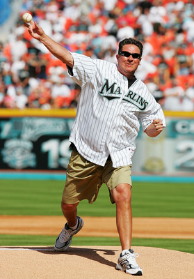 MIAMI - APRIL 5:  Football Hall of Famer Dan Marino throws out the opening pitch before the  Atlanta Braves play the Florida Marlins at Dolphins Stadium on April 5, 2005 in Miami, Florida.  (Photo by Matthew Stockman/Getty Images)