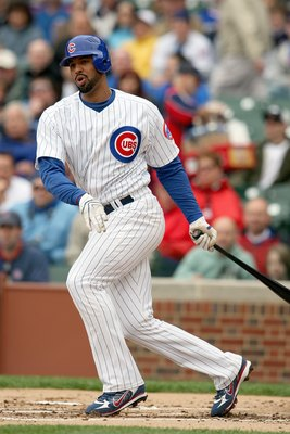 CHICAGO - MAY 09:  Derrek Lee #25 of the Chicago Cubs swings at a pitch during the game against the Arizona Diamondbacks on May 9, 2008 at Wrigley Field in Chicago, Illinois. The Cubs defeated the Diamondbacks 3-1. (Photo by Jonathan Daniel/Getty Images)