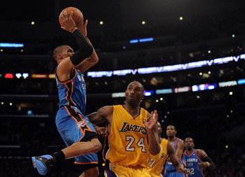 LOS ANGELES, CA - JANUARY 17:   Russell Westbrook #0 of the Oklahoma City Thunder shoots a jumper over Kobe Bryant #24 of the Los Angeles Lakers during a 101-94 Laker win at the Staples Center on January 17, 2011 in Los Angeles, California.   NOTE TO USER