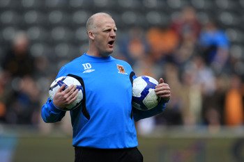 HULL, ENGLAND - MAY 9: Hull City interim manager Iain Dowie shouts instructions as he holds two footballs during the Barclays Premier League match between Hull City and Liverpool at the KC Stadium on May 9, 2010 in Hull, England. (Photo by Jed Leicester/G