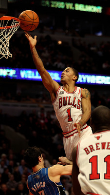 CHICAGO, IL - JANUARY 28: Derrick Rose #1 of the Chicago Bulls puts up a shot over J.J. Redick #7 of the Orlando Magic at the United Center on January 28, 2011 in Chicago, Illinois. The Bulls defeated the Magic 99-90. NOTE TO USER: User expressly acknowle