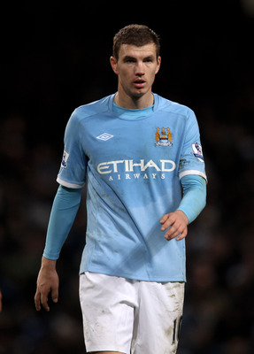 MANCHESTER, ENGLAND - JANUARY 15:  Edin Dzeko of Manchester City looks on during the Barclays Premier League match between Manchester City and Wolverhampton Wanderers at the City of Manchester Stadium on January 15, 2011 in Manchester, England.  (Photo by