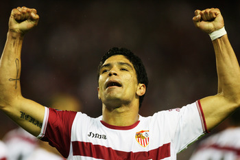 SEVILLA, SPAIN - MAY 03:  Renato of Sevilla celebrates his goal during the UEFA Cup semi final second-leg match between Sevilla and Osasuna at the Sanchez Pizjuan stadium on May 5, 2007 in Sevilla, Spain.  (Photo by Clive Rose/Getty Images)