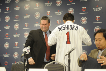 MINNEAPOLIS, MN - DECEMBER 18: Tsuyoshi Nishioka # of the Minnesota Twins puts on his first Twins jersey during a press conference on December 18, 2010 at Target Field in Minneapolis, Minnesota. (Photo by Hannah Foslien /Getty Images)
