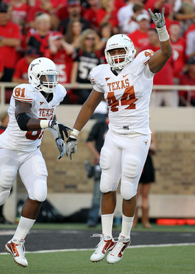 LUBBOCK, TX - SEPTEMBER 18:  Jackson Jeffcoat #44 of the Texas Longhorns celebrates a fumble recovery with Sam Acho #81 in the first quarter against the Texas Tech Red Raiders at Jones AT&T Stadium on September 18, 2010 in Lubbock, Texas.  (Photo by Ronal
