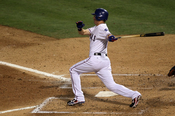 ARLINGTON, TX - OCTOBER 30:  Michael Young #10 of the Texas Rangers hits a single in the bottom of the third inning against the San Francisco Giants in Game Three of the 2010 MLB World Series at Rangers Ballpark in Arlington on October 30, 2010 in Arlingt