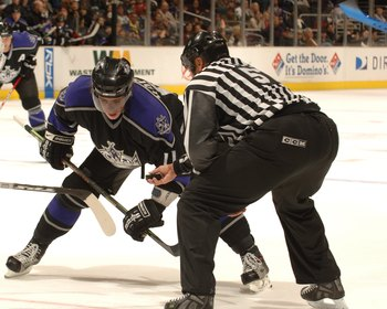 LOS ANGELES - DECEMBER 16:  Stu Barnes #14 of the Dallas Stars faces off against Anze Kopitar #11 of the Los Angeles Kings at Staples Center on December 16, 2006 in Los Angeles, California. The Stars won 4-3 in a shootout. (Photo by Noah Graham/Getty Imag