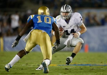 PASADENA, CA - SEPTEMBER 19:  Quarterback Carson Coffman #14 of the Kansas State Wildcats is met by Akeem Ayers #10 of the UCLA Bruins in the first half at the Rose Bowl on September 19, 2009 in Pasadena, California.  (Photo by Jeff Gross/Getty Images)