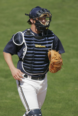 PHOENIX, AZ - MARCH 4:  Catcher Damian Miller #26 of the Milwaukee Brewers jogs during the spring training game against the Seattle Mariners on March 4, 2005 at Maryvale Baseball Park in Phoenix, Arizona.  the Brewers won 8-1.  (Photo by Brian Bahr/Getty