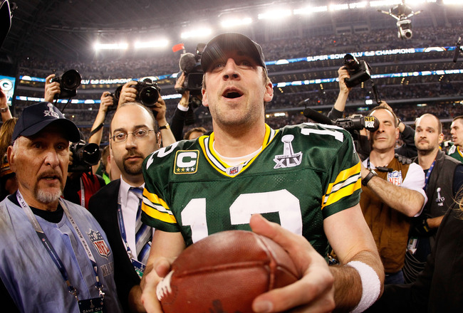 ARLINGTON, TX - FEBRUARY 06:  Super Bowl MVP Aaron Rodgers #12 of the Green Bay Packers celebrates after winning Super Bowl XLV 31-25 against the Pittsburgh Steelers at Cowboys Stadium on February 6, 2011 in Arlington, Texas.  (Photo by Kevin C. Cox/Getty