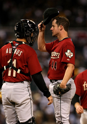 SAN DIEGO - MARCH 31:  Pitcher Roy Oswalt #44 of the Houston Astros  adjusts his cap as he meets on the mound with catcher Brad Ausmus #11 in the game against the San Diego Padres on March 31, 2008 at Petco Park in San Diego, California.   (Photo by Steph