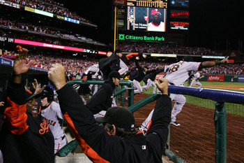 PHILADELPHIA - OCTOBER 23:  The San Francisco Giants celebrate defeating the Philadelphia Phillies 3-2 and winning the pennant in Game Six of the NLCS during the 2010 MLB Playoffs at Citizens Bank Park on October 23, 2010 in Philadelphia, Pennsylvania.  (