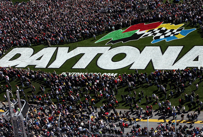 DAYTONA BEACH, FL - FEBRUARY 14:  Fans crowd the infield trioval grass during pre-race festivities before  the NASCAR Sprint Cup Series Daytona 500 at Daytona International Speedway on February 14, 2010 in Daytona Beach, Florida.  (Photo by Jonathan Ferre