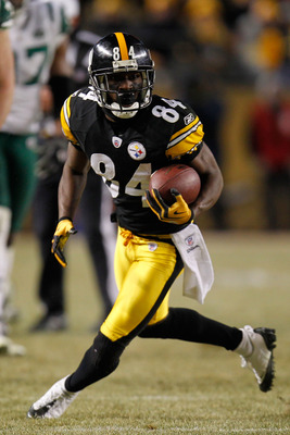PITTSBURGH, PA - JANUARY 23:  Antonio Brown #84 of the Pittsburgh Steelers runs down field against the New York Jets during the 2011 AFC Championship game at Heinz Field on January 23, 2011 in Pittsburgh, Pennsylvania. The Steelers defeated the Jets 24 to