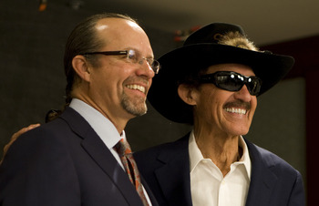 CHARLOTTE, NC - MAY 23: Richard Petty has his picture taken with his son Kyle Petty before the Inaugural Induction Ceremony at the NASCAR Hall of Fame on May 23, 2010 in Charlotte, North Carolina. (Photo by Chris Keane/Getty Images for NASCAR)