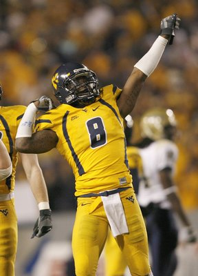 MORGANTOWN, WV - DECEMBER 1: Quinton Andrews #8 of the West Virginia Mountaineers celebrates on the field during the game against the Pittsburgh Panthers at Milan Puskar Stadium on December 1, 2007 in Morgantown, West Virginia. (Photo by Kevin C. Cox/Gett
