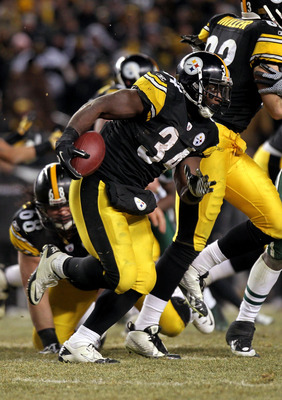 PITTSBURGH, PA - JANUARY 23:  Rashard Mendenhall #34 of the Pittsburgh Steelers runs the ball against the New York Jets during the 2011 AFC Championship game at Heinz Field on January 23, 2011 in Pittsburgh, Pennsylvania. The Steelers won 24-19.  (Photo b
