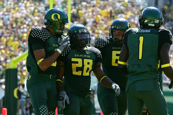 EUGENE, OR - SEPTEMBER 2:  Running back Jonathan Stewart #28 of the Oregon Ducks celebrates a touchdown with teammates during the game against the Stanford Cardinal on September 2, 2006 at Autzen Stadium in Eugene, Oregon. The Ducks won 48-10.  (Photo by
