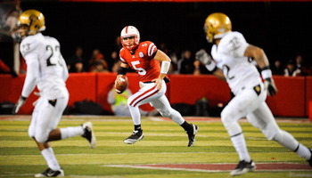 LINCOLN, NE - NOVEMBER 26: Zac Lee #5 of the Nebraska Cornhuskers looks downfield on the Colorado Buffaloes during their game at Memorial Stadium on November 26, 2010 in Lincoln, Nebraska. Nebraska defeated Colorado 45-17 (Photo by Eric Francis/Getty Imag