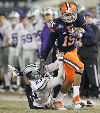NEW YORK, NY - DECEMBER 30: Alec Lemon #15 of the Syracuse Orange is tackled by Emmanuel Lamur #23  of the Kansas State Wildcats during the New Era Pinstripe Bowl at Yankee Stadium on December 30, 2010 in New York, New York.  (Photo by Chris McGrath/Getty