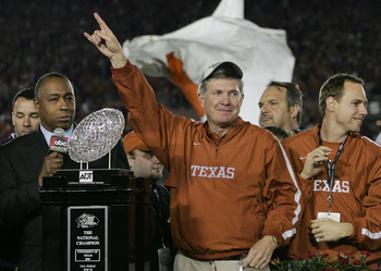 PASADENA, CA - JANUARY 04:  Head coach Mack Brown of the Texas Longhorns celebrates with the National Championship trophy after defeating the USC Trojans 41-38 to win the BCS National Championship Rose Bowl Game on January 4, 2006 in Pasadena, California.