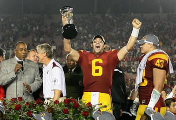 PASADENA, CA - JANUARY 01:  Quarterback Mark Sanchez #6 of the USC Trojans celebrates with the 95th Rose Bowl Game trophy after defeating the Penn State Nittany Lions at the Rose Bowl on January 1, 2009 in Pasadena, California. The Trojans defeated the Ni