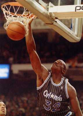 17 Nov 1993: Center Shaquille O''Neal of the Orlando Magic slam dunks against the Chicago Bulls during the ''92-''93 season at the United Center in Chicago, Illinois.