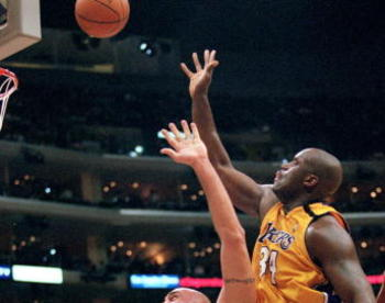 31 Mar 2000:  Matt Geiger #52 of the Philadelphia 76ers jumps to block a shot from Shaquille O''Neal of the Los Angeles Lakers during the game against the Los Angeles Lakers at the Staples Center in Los Angeles, California. The Lakers defeated the 76ers 1