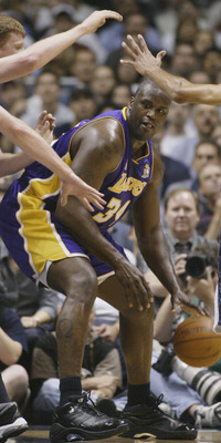 EAST RUTHERFORD, NJ - JUNE 12:  Shaquille O'Neal #34 of the Los Angeles Lakers is defended by Todd MacCulloch #11 of the New Jersey Nets in Game four of the 2002 NBA Finals on June 12, 2002 at Continental Airlines Arena in East Rutherford, New Jersey. The