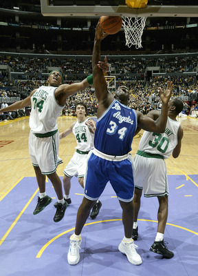 LOS ANGELES - DECEMBER 28:  Shaquille O'Neal #34 of  the Los Angeles Lakers grabs a rebound in front of Paul Pierce #34, Jiri Welsch #44 and Mark Blount #30 of the Boston Celtics on December 28, 2003 at Staples Center in Los Angeles, California. The Laker