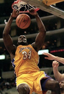 5 Dec 1999: Shaquille O''Neal #34 of the Los Angeles Lakers makes a slam dunk during the game against the Orlando Magic at the Staples Center in Los Angeles, California. The Lakers defeated the Magic 117-100.  Mandatory Credit: Kellie Landis  /Allsport