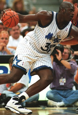 24 Oct 1994: SHAQUILLE O''NEAL OF THE ORLANDO MAGIC ROUNDS A PHOENIX SUNS PLAYER DURING THE SUNS'' 135-129 WIN AT THE ORLANDO ARENA IN FLORIDA.